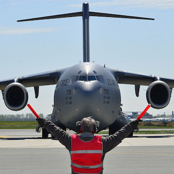 Airman marshalling a C-17 Globemaster I (U.S. Air Force photo by Airman 1st Class William Johnson/Released)