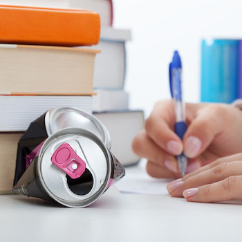 Energy drink can and text books
