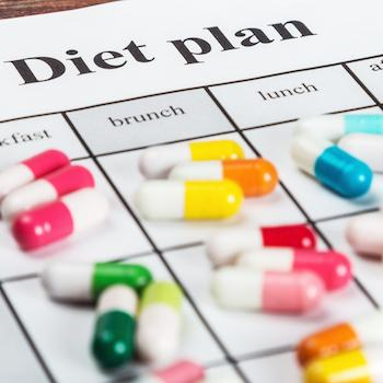 "Pills on a paper with the words ""Diet plan"""